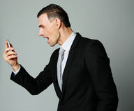 Businessman yelling on his cell phone Stock Photos