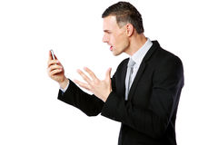 Businessman yelling on his cell phone stock image