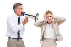 Businessman yelling at his coworker with megaphone. Mature businessman yelling at his coworker with megaphone on white background Royalty Free Stock Image