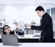 Businessman yelling at his employee. Businessman is yelling at his employee in office Stock Images