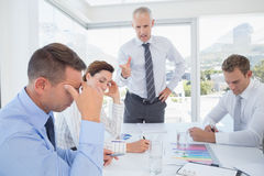 Businessman yelling at his team Stock Images