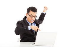 Businessman yelling and make a fist with laptop Stock Images
