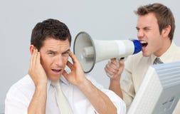 Businessman yelling through a megaphone Royalty Free Stock Image