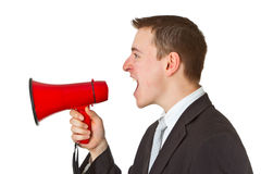 Businessman yelling through a megaphone Stock Image