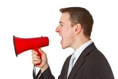 Businessman yelling through a megaphone. Isolated on white background Stock Image