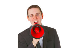 Businessman yelling through a megaphone Royalty Free Stock Photography