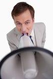 Businessman yelling through megaphone Royalty Free Stock Image