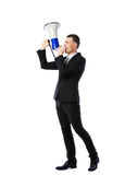 Businessman yelling through megaphone Stock Photo