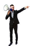 Businessman yelling through megaphone Stock Photos