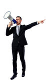 Businessman yelling through megaphone Stock Images