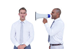 Businessman yelling with a megaphone at his colleague Royalty Free Stock Images