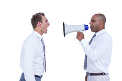 Businessman yelling with a megaphone at his colleague Stock Photos