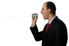 Businessman yelling through an oldschool can phone Stock Photos