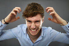 Businessman yelling over gray background Royalty Free Stock Photography