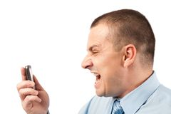Businessman yelling on phone Royalty Free Stock Photos