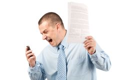 Businessman yelling on phone. Portrait of a young businessman yelling on phone, isolated on white background Stock Image
