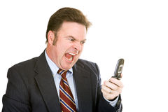Businessman Yelling into Phone. Angry businessman yelling into his cellphone.  Isolated on white Royalty Free Stock Photos