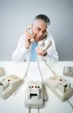 Businessman yelling into phone Stock Photos