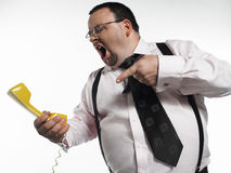 Businessman Yelling At Telephone Receiver. Against white background Stock Photography