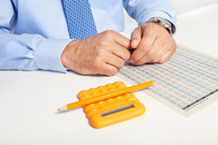 The businessman and yellow calculator Royalty Free Stock Image