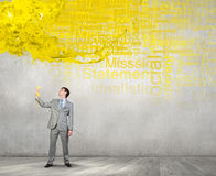 Businessman with yellow receiver Royalty Free Stock Images