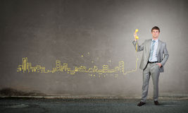 Businessman with yellow receiver Royalty Free Stock Photography