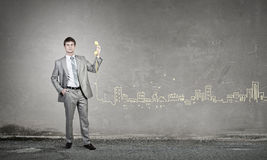 Businessman with yellow receiver Stock Photography