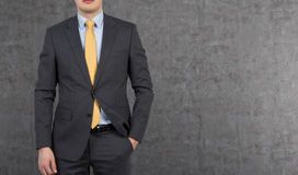 Businessman in yellow tie Royalty Free Stock Photography