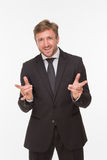 Businessman with yo signs over white background Royalty Free Stock Image