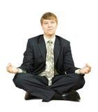 Businessman  in yoga lotus pose Stock Images