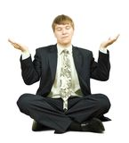 Businessman in yoga position Stock Photography