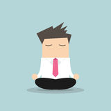 Businessman yoga relaxing during hard workday Royalty Free Stock Photos