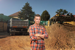 Businessman young at the beginning of the construction work. building concept. Look in the cam. Royalty Free Stock Image