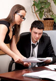 Businessman and young female assistant Royalty Free Stock Images
