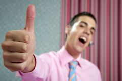 Businessman young with okay hand sign. Businessman young with okay sign in his hand over wallpaper background stock image