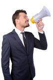 Businessman. Young businessman screaming into megaphone over white background Stock Photo