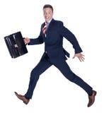 Businessmand che scorre veloce con una cartella Fotografia Stock Libera da Diritti