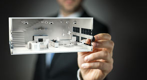 Businessmank drawing white 3D rendering apartment plan. Businessman on blurred background drawing white 3D rendering apartment plan Stock Photos