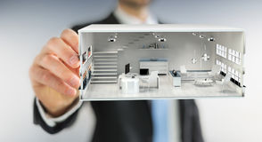 Businessmank drawing white 3D rendering apartment plan. Businessman on blurred background drawing white 3D rendering apartment plan Royalty Free Stock Image
