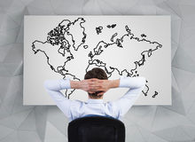 Businessmanlooking to world map Stock Image
