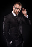 Businessmanman in black suit and glasses Stock Images