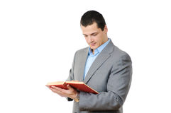 Businessmanman holding a book Stock Images