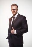 Businessmanman in zwarte kostuum en glazen Royalty-vrije Stock Fotografie