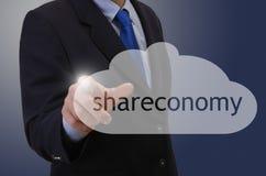 Businessmann touching shareconomy symbol Stock Photo