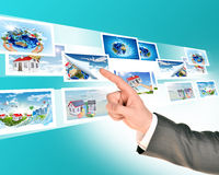 Businessmans arm with holographic photos Stock Image
