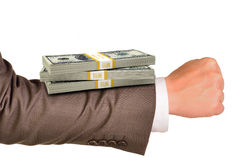 Businessmans arm with money Royalty Free Stock Photos