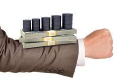 Businessmans arm with money Stock Photo