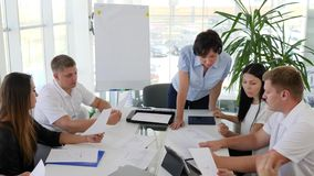 Businessmans discussing conclude of contract with collaborators in modern office with large panoramic windows. Businessmans discussing conclude of contract with stock footage