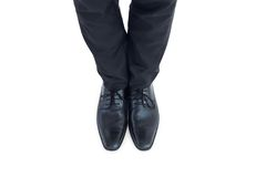 Businessmans feet in black brogues Stock Images