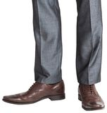 Businessmans feet in brown brogues Royalty Free Stock Image